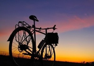 Silhouette of a bike against a sunset sky