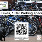 A pile of bikes with a black cat in the foreground. QR code links to www.recyculture.co.uk Search for '20 bikes...'