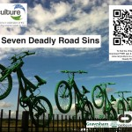 7 green bikes leap from a fence, QR code links to www.recyculture.co.uk Search for 'Seven Deadly...'