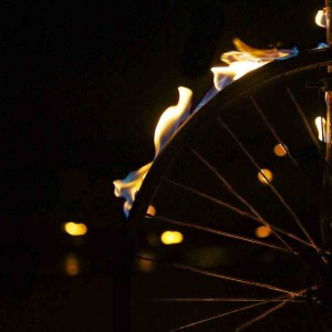 Close up of a bike wheel, with the tyre aflame